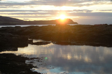 Sun setting over Treshnish                                       headland
